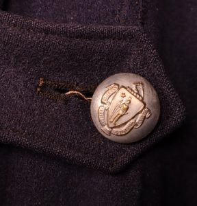 Detail of button on cape