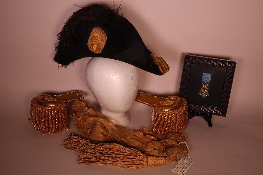 F. Dodge bicorn hat, epaulets, sash, medal